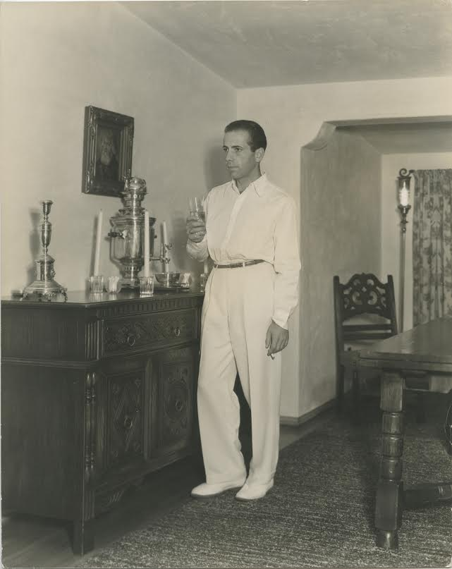 Humphrey Bogart enjoying a drink at home